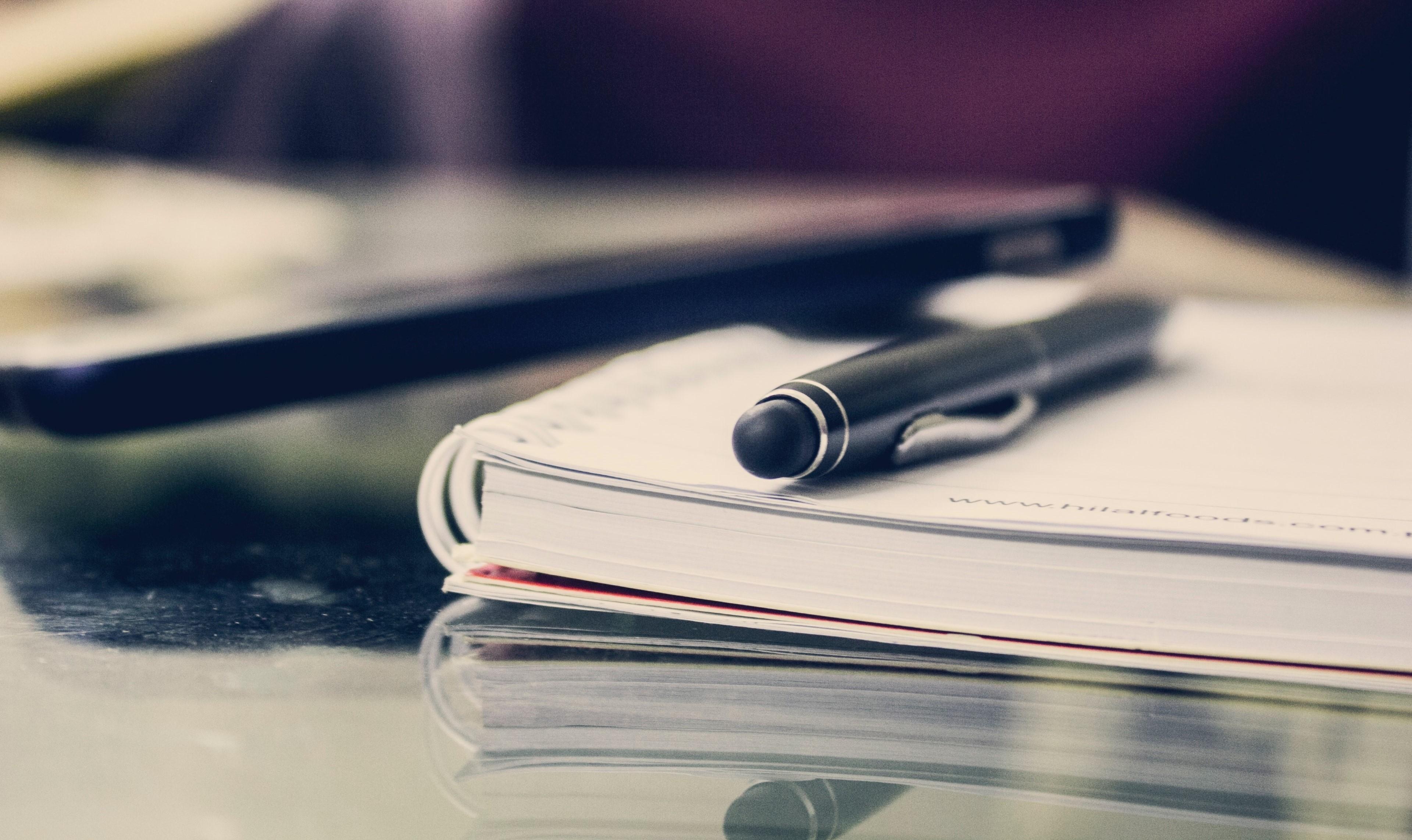 black-twist-pen-on-notebook-891059 2